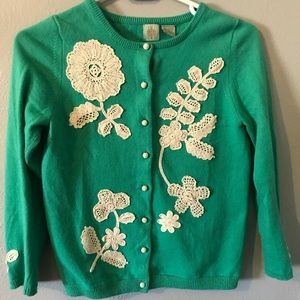 Green wool sweater with lace detail